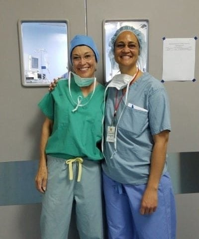 Dr. Pinkerton and her colleague outside of the Operating Room